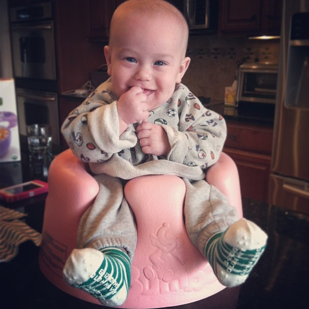 Reed using baby Heavens #bumbo :) soooo cute!! @curiousgeorgi