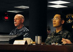 Commander, 7th Fleet Vice Adm. Scott H. Swift, left, and Republic of Korea Navy Rear Adm. Dong Woo Park receive a  briefing aboard 7th Fleet flagship USS Blue Ridge (LCC 19), March 12 in the South China Sea during exercise Key Resolve 2013. (U.S. Navy photo)