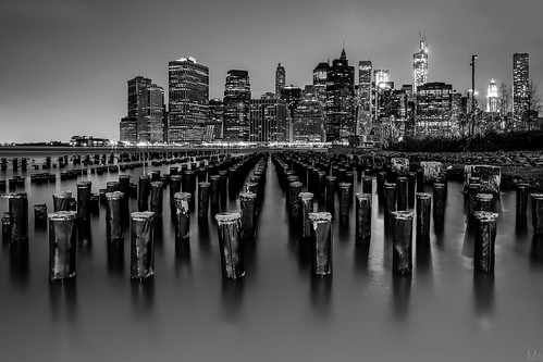 park city nyc newyorkcity longexposure blackandwhite ny newyork tower water monochrome skyline brooklyn night skyscraper buildings print puddle photography pier photo downtown gallery cityscape unitedstates image manhattan worldtradecenter fineart stock scenic picture dumbo canvas wtc pylons pillars piles brooklynbridgepark tower1 freedomtower downtowncity dumbopark mikeorso