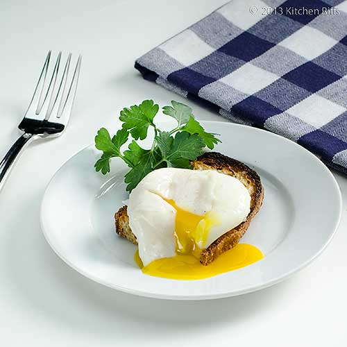Poached Egg on Toast with fork and napkin in background