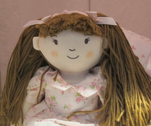 a doll with brown hair