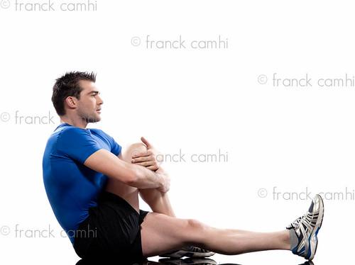 man Worrkout Posture Yoga Marichyasana stretching workout posture by a man on studio white background
