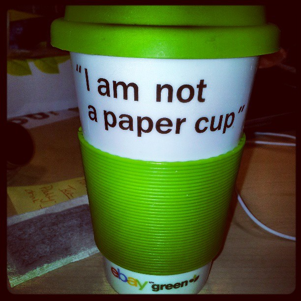 Hooray! The recycleable coffee mug has joined the battle and brought his own slogan!! I am NOT a paper cup!! #standoff #cookiewars #officehumor #office #humor #fridayfun #friday #fun #greenteam #laugh #allinadayswork #whilethecatisawaythemicewillplay