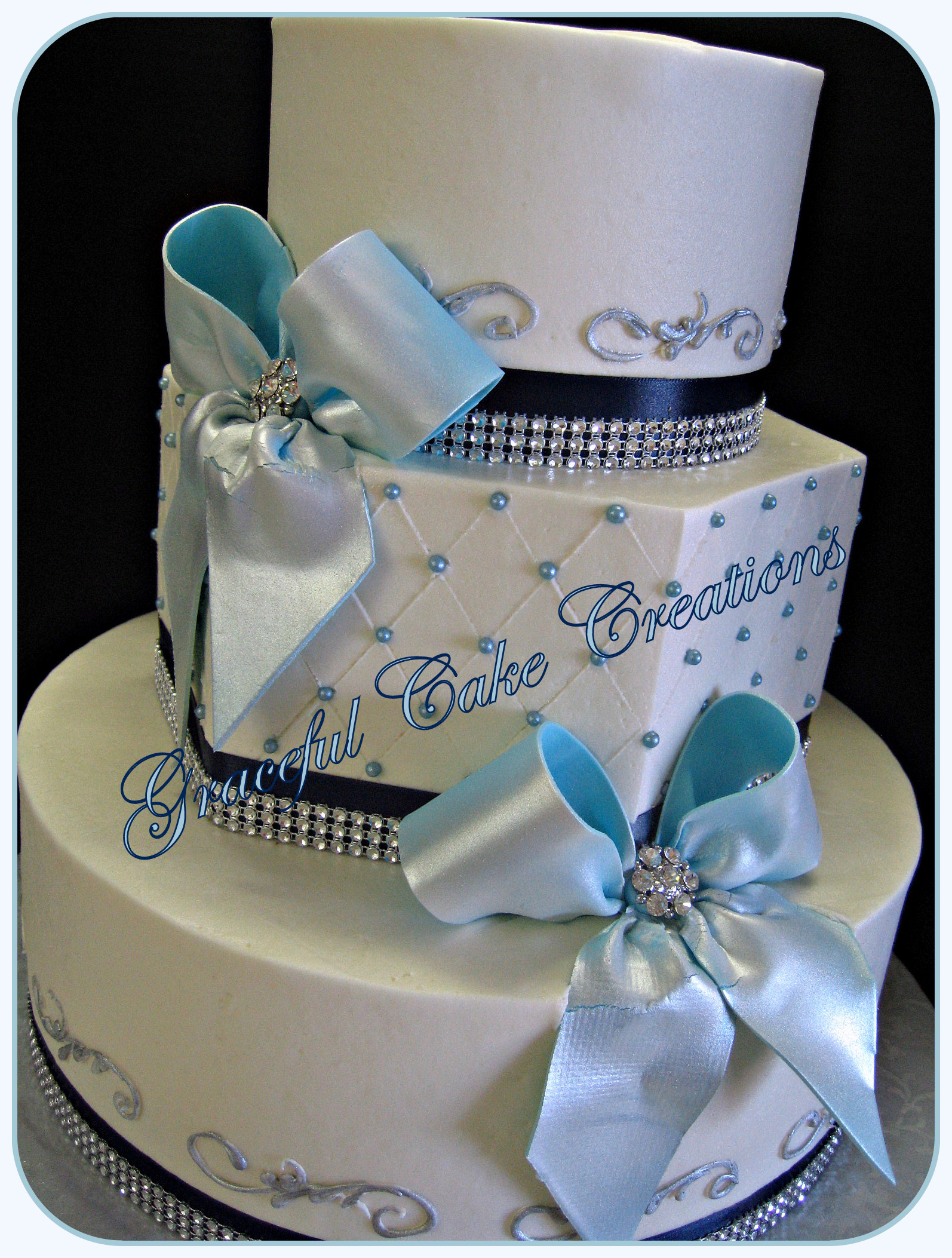 Elegant White Wedding Cake with Navy Blue and Bling Ribbon