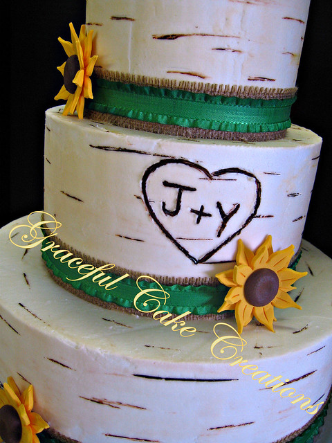 White Birch Wedding Cake With Burlap Ribbon And Sunflowers