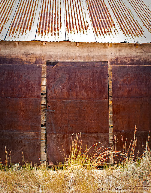 three sliding barn doors rusted to a beautiful russet patina