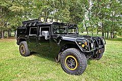 jeep wrangler(0.0), automobile(1.0), automotive exterior(1.0), military vehicle(1.0), sport utility vehicle(1.0), vehicle(1.0), hummer h1(1.0), off-roading(1.0), hummer h2(1.0), off-road vehicle(1.0), bumper(1.0), land vehicle(1.0), luxury vehicle(1.0), motor vehicle(1.0),