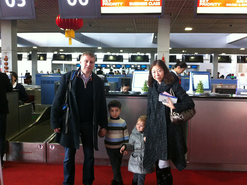Checking in for our flight from China to Vancouver