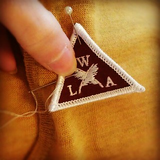 Sewing patches onto sweaters.