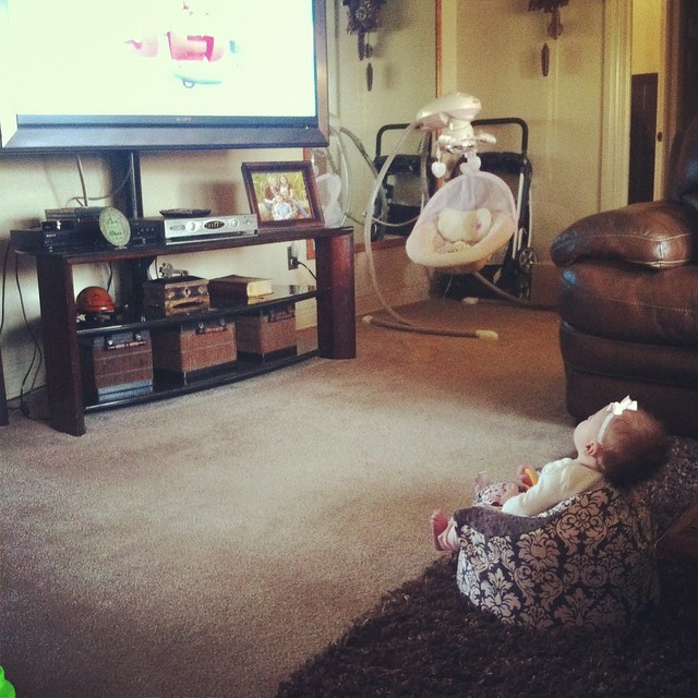 watching TV in her Bumbo