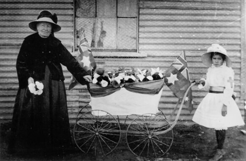 Selling flowers to raise funds for the Red Cross, Thargomindah, ca. 1916 by State Library of Queensland, Australia