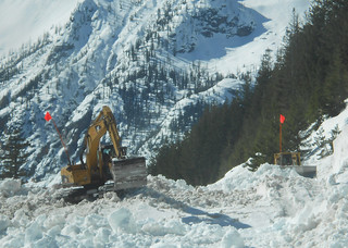 Excavator and a dozer working avalanche chute