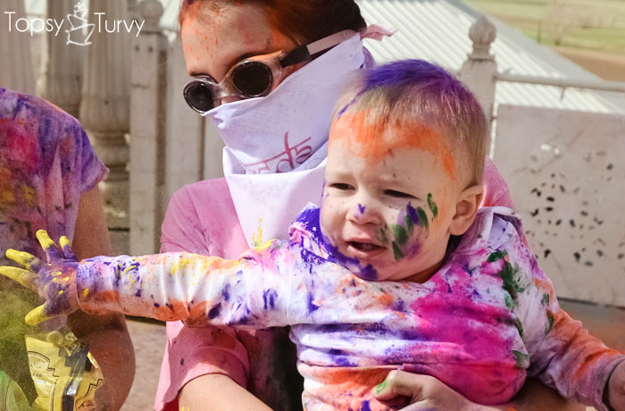 festival-color-baby-boy-throwing