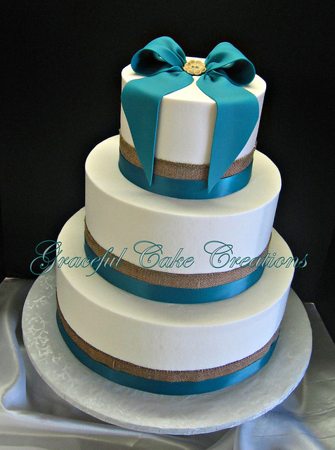 A Simple White Wedding Cake with Burlap and Teal Blue ...