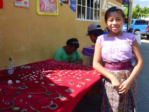 Candelaria at her dad's jewelry table