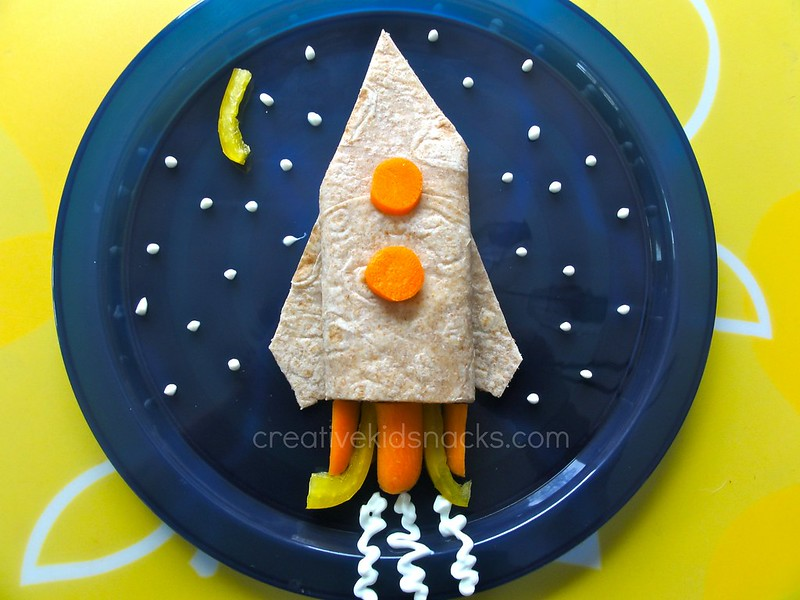 Rocket kids lunch by CreativeKidSnacks.com | Turkey breast in a whole wheat tortilla wrap (high fiber and protein) with carrots & yellow peppers.  Made this for my own kids using technique shown in post with unsweetened GREEK yogurt and they ate it all up