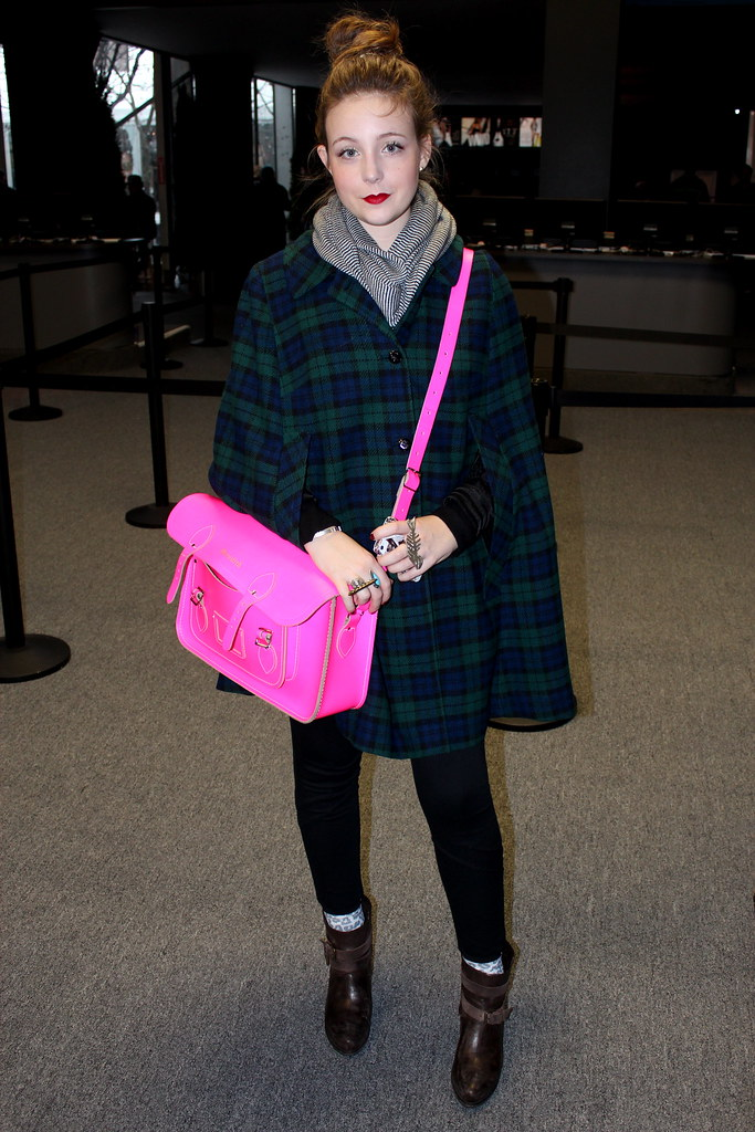 fluorescent pink satchel and plaid cape