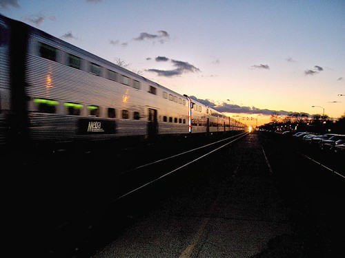 Westbound Metra express commuter train heads off in to the winter sunset.  Berwyn Illinois.  January 2007. by Eddie from Chicago