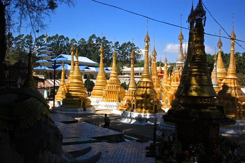 gold stupas outside of the cave of Buddhas