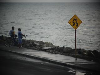 Image of Muralla de Cartagena near Cartagena. street sea southamerica bike sign mar calle fishing colombia bicicleta malecon letrero cartagena costanera sudamerica pescando señaletica cartagenadeindias sothamerica