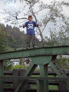 Daredevil Red-Headed Boy in Risky Spot on Bridge
