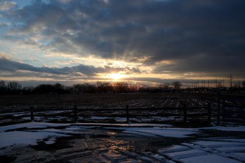 sunset sun snow reflections spring tracks sunburst sunbeams chicagoist mudonthetires pwwinter