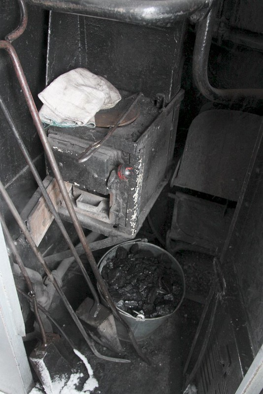 Coal fired stove in our sleeping carriage for heating and hot water