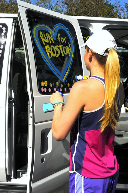 Lauren @laurenolerich decorating our Ragnar Relay SoCal van with some Run for Boston Love