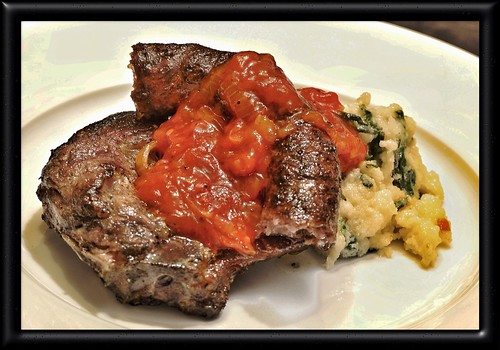 Pork chop, wors, tomato relish & spinach and garlic pap