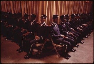 """The Fruit Of Islam"", A Special Group Of Bodyguards For Muslim Leader Elijah Muhammad, Sit At The Bottom Of The Platform While He Delivers His Annual Savior's Day Message In Chicago, 03/1974"