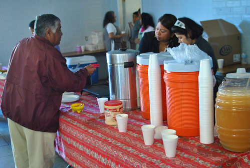 Man buying coffee at Santa Cecilia Church