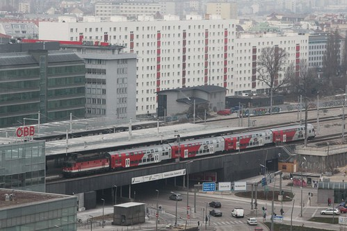 Double decked CityShuttle 'Wiesel' train operated by ÖBB departs the station with the loco on the rear