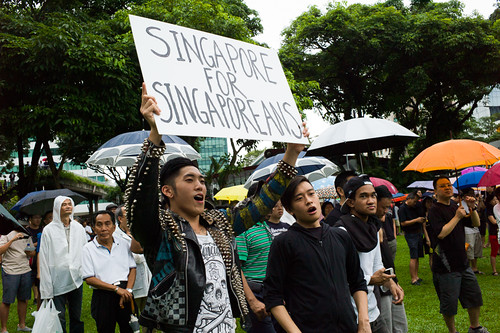 """A youth holds up a placard proudly proclaiming """"Singapore for Singaporeans"""" at the historic protest in Singapore against the government's population white paper, the largest bi-partisan protest since Singapore's Independence."""