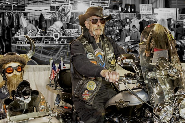 "Another image from the Timonium Motorcycle Show last weekend. Here a proud owner strikes a poise for me on his ""Custom""  Harley while some friends try to sneak a ride in the sidecar.   NIK ""Color Efex Pro 4"" ""Silver Efex Pro 2""    © 2013 Doug Miller Photography  <a href=""http://www.dougmillerphotos.com"" rel=""nofollow"">www.dougmillerphotos.com</a>  <a href=""http://www.speedovision.com"" rel=""nofollow"">www.speedovision.com</a>"