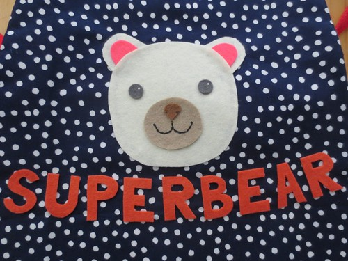 Superbear baby cape detail