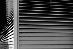 window(0.0), wood(0.0), shutter(0.0), siding(0.0), white(1.0), light(1.0), line(1.0), monochrome photography(1.0), window blind(1.0), monochrome(1.0), black-and-white(1.0), black(1.0),