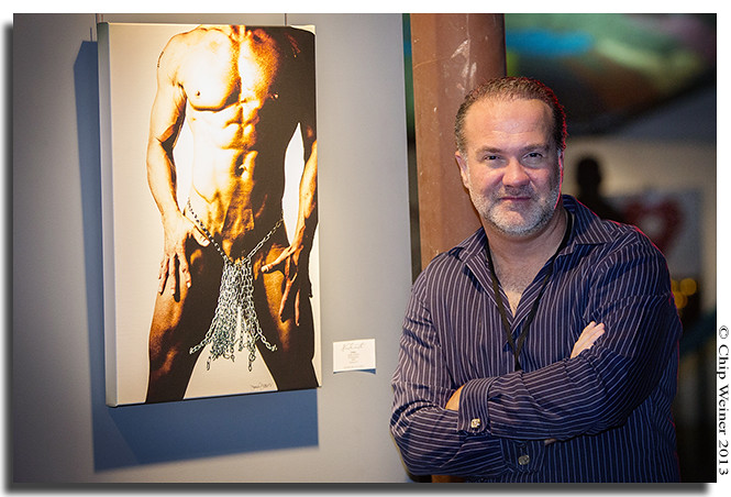 Artist Jamie Jackson next to his photograph Chains