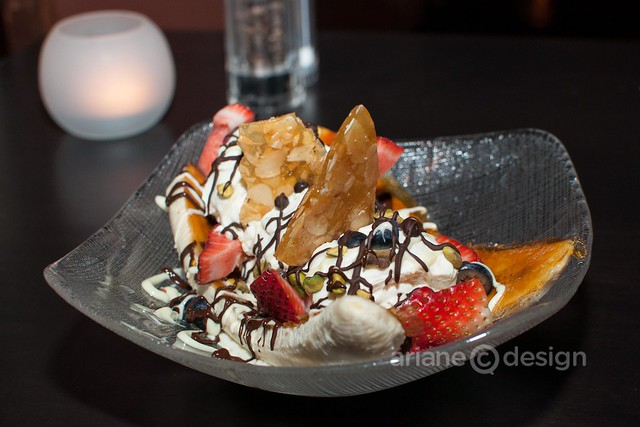 Banana split with caramelized banana, vanilla ice cream, almond brittle, chocolate sauce