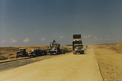 vehicle(1.0), plain(1.0), natural environment(1.0), desert(1.0), landscape(1.0), dust(1.0),