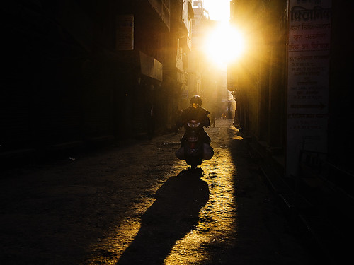 morning nepal sun sunrise scooter motorcycle kathmandu rider contresoleil