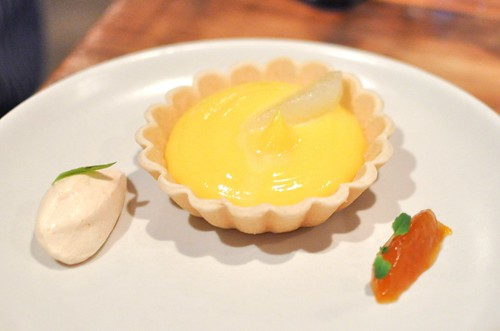 yuzu tartlet, oro blanco, candied kumquat, whipped orange