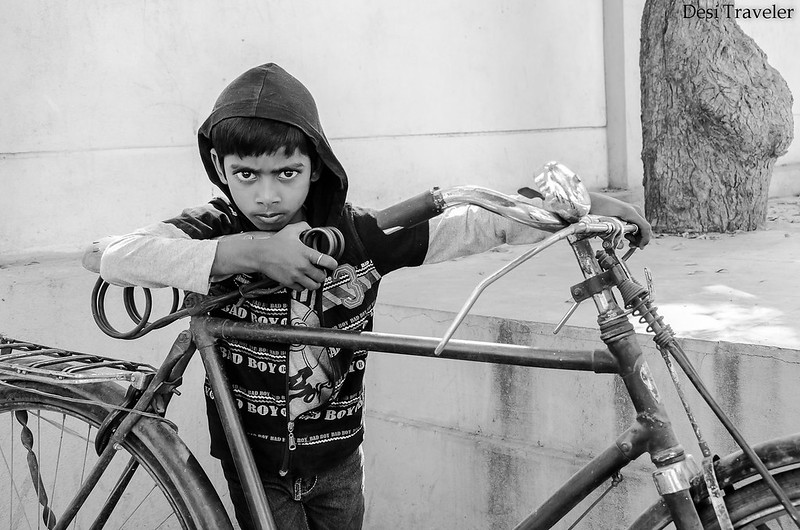 portrait of a boy with his cycle