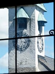 Trough the museum window, Clock Tower of the Hohensalzburg Fortress in Salzburg Austria