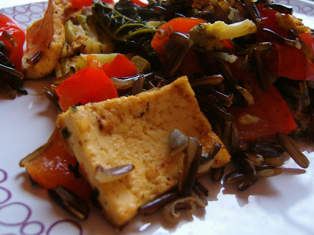 Wild rice with grilled tofu and steamed red pepper, kale a ...