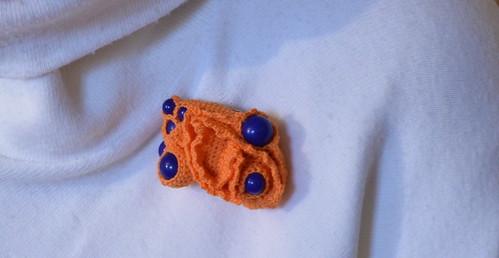 Crochet brooch- Orange sponge