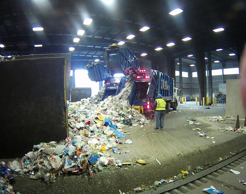 Collections Field Staffer Kelly Boyle observes incoming recyclables