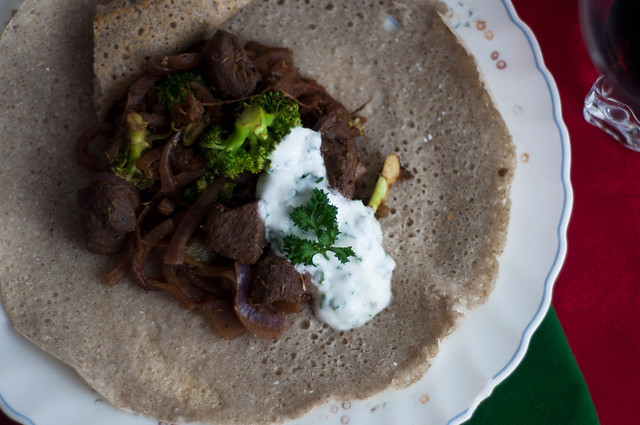 ethiopian stewed caribou on buckwheat injera
