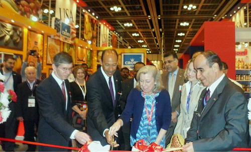 U.S. Ambassador to the United Arab Emirates Michael Corbin (second from left) and Foreign Agricultural Service (FAS) Administrator Sue Heinen cut a ceremonial ribbon during the opening ceremony for the USA pavilion at the 2013 Gulfood trade show as Consul General Rob Waller (far left) and the USA pavilion organizers exhibitors look on.
