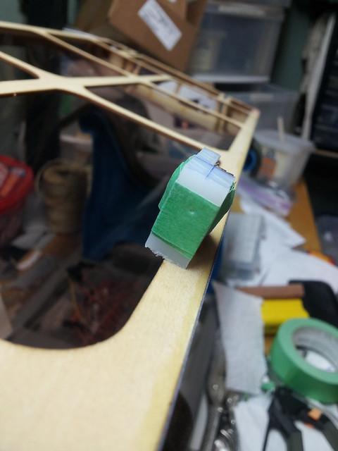 Port latch - latch pin registered
