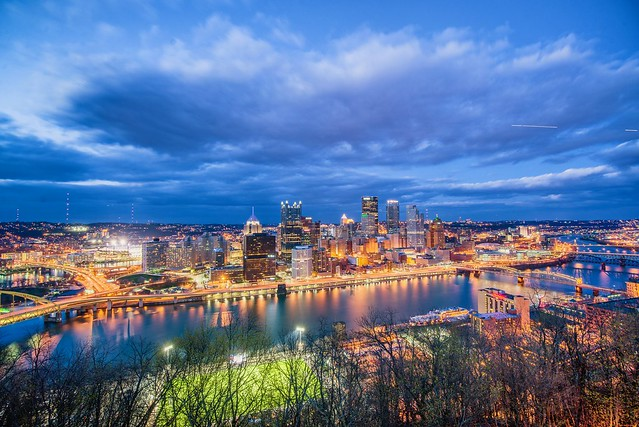 Clouds race over the Pittsburgh skyline at the blue hour in HDR